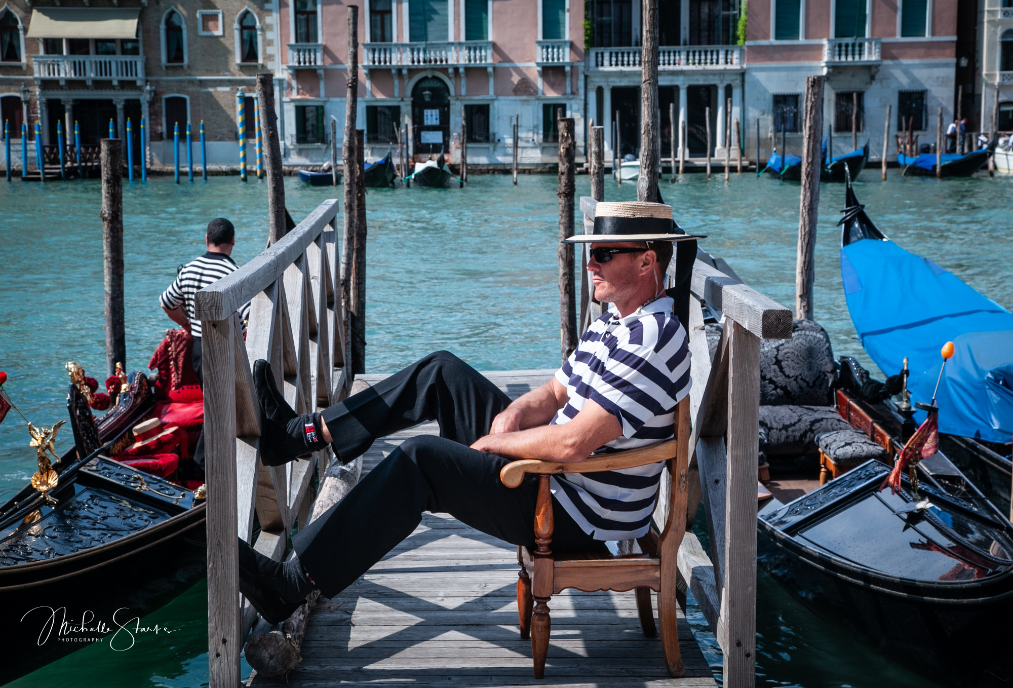 Gondolier at rest, Venice, Italy